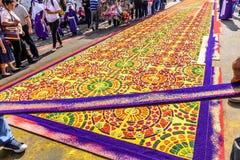 Making dyed sawdust Good Friday procession carpet, Antigua, Guatemala royalty free stock image