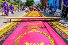 Making dyed sawdust Holy Thursday carpet, Antigua, Guatemala stock photos