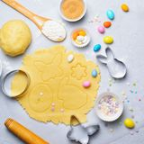 Making of Easter Cookies, Baking Background, Dough, Cookie Cutters, Sugar Sprinkles. Making of Easter Cookies, Dough, Cookie Cutters, Sugar Sprinkles, Festive stock photos