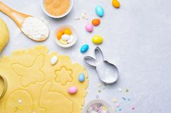 Making of Easter Cookies, Baking Background, Dough, Cookie Cutters, Sugar Sprinkles. Making of Easter Cookies, Dough, Cookie Cutters, Sugar Sprinkles, Festive royalty free stock photo