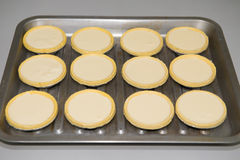 Making egg tarts Stock Photo