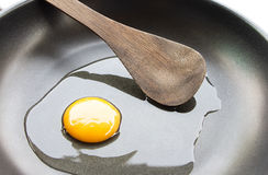 Making eggs in a saucepan and wooden ladle. Closeup Stock Photos