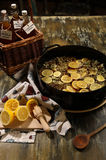 Making the Elderflower cordial - third step wih finished product Royalty Free Stock Photography