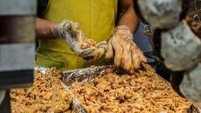 Making Eomuk, Korean street food. Fried fish cake, sausage in Se stock images