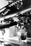 Making espresso coffee close up detail with modern machine Royalty Free Stock Image