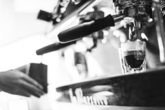 Making espresso coffee close up detail with modern machine stock image