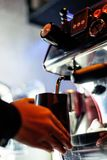 Making espresso coffee close up detail with modern machine stock photo