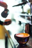 Making espresso coffee close up detail with modern machine royalty free stock photo