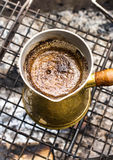 Making espresso coffee in vintage coffee pot on a grill bar outd Stock Photos
