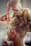 Making evening hairstyle Stock Photos