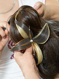Making evening woman coiffure Royalty Free Stock Image