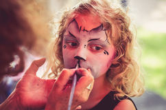 Making face painting of cat Stock Image