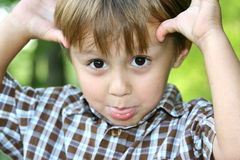 Making faces. Young boy making faces at the camera Royalty Free Stock Images