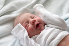 Making faces. Baby boy making funny faces while sleeping royalty free stock photo