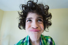 Making Faces. Hispanic child making faces and mocking his siblings Royalty Free Stock Photo