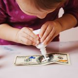 Making fake dollars. Drawing process of counterfeit money humor. Ous photo stock images