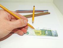 Making fake money. Drawing process of counterfeit money royalty free stock image