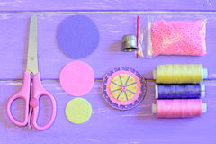 Making felt flower for pins, brooches, decorations or embellishments. Flower made of felt circles and beads, handcraft supplies. Easy craft tutorial to make felt Royalty Free Stock Images