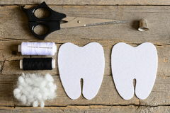 Making a felt tooth fairy. Step. Instruction. Cut felt parts to make a felt tooth fairy. Scissors, thread, thimble, needle, filler Royalty Free Stock Images