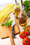 Making fettuccine with sauce and basil Stock Photo
