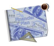 Making a financial plan is illustrated with a mock blueprint of a financial plan with coffee, ruler, pencil and notes royalty free stock images