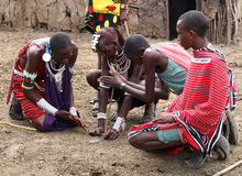 Making fire. MASAI MARA - JUNE 23: Picture of some masai making a fire without matches. June 23, 2007 in Kenya Stock Photo