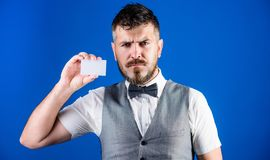 Making first impression that counts. Bearded man holding business card. Businessman with bank card. Hipster with credit. Card. Empty card for your contact royalty free stock image