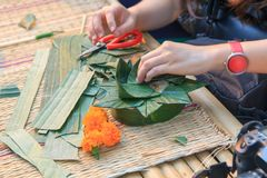 Making the floating basket by banana leaf. / banana leave vessel royalty free stock photography