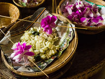Making flower garland that called Malai in Thai.  Royalty Free Stock Images