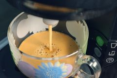Making fresh coffee with foam with a coffee maker. 1 stock images