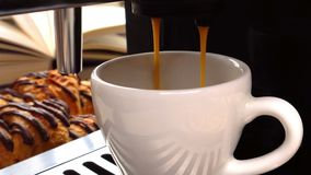 Making fresh coffee going out from a coffee espresso machine croissant in the background. Slow motion stock footage