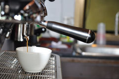 Making fresh coffee via steaming machines, Royalty Free Stock Image