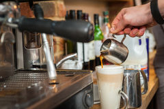 Making fresh late coffee Royalty Free Stock Photography