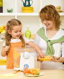Making fresh orange juice Stock Images