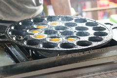 Making Fried Quail Eggs on hot plate Stock Photos