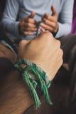 Making a friendship bracelet Stock Photos