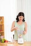 Making fruit smoothie Royalty Free Stock Photo