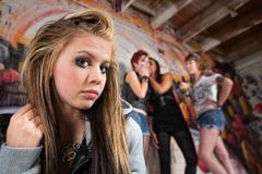 Making Fun of Teenager. Group of people making fun of sad blond teenager Royalty Free Stock Photo