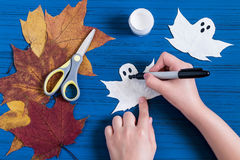 Making ghosts from maple leaves to Halloween. Step 4 royalty free stock photo