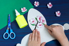 Making gift box by the child for Mother`s Day. Step 9 Stock Images