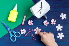 Making gift box by the child for Mother`s Day. Step 8. Making gift box by the child for Mother`s Day. Children`s art project. DIY concept. Step-by-step photo royalty free stock images