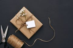Making gift with soul...Design your own gift box with kraft paper, ribbon and scissors. Making gift with soul...Gift box with kraft paper, ribbon and scissors stock images