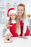 Making a gingerbread cookie house at christmas Royalty Free Stock Photo