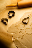 Making gingerbread cookies Royalty Free Stock Image