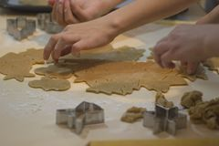 Making gingerbread cookies. Christmas baking background dough and cookie cutters stock photography