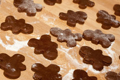 Making gingerbread cookies Stock Images