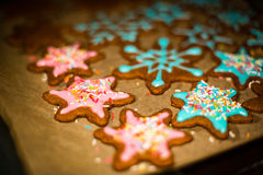 Making Gingerbread Cookies Series. Preparing and cutting dough s. Womans hand decorating cookies with sugar. Making Gingerbread Cookies Series Royalty Free Stock Image