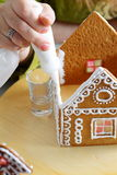 Making of gingerbread house. Making of christmas gingerbread house. Roof binding stock photos