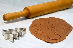 Making gingerbread man. And christmas cookies Royalty Free Stock Image