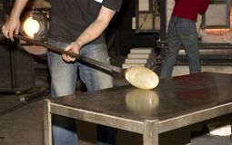 Making glass. Artist making a glass vase on the glass factory royalty free stock photo